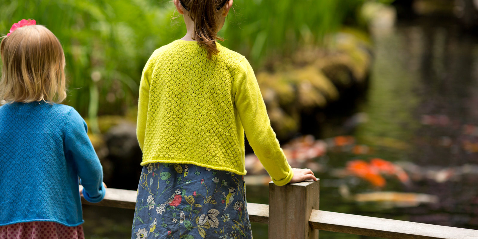 Sisters view the Koi on Children's Day. Photo by Scott Ryan